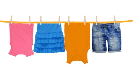 laundry line: Laundry line with clothes isolated on white background Stock Photo
