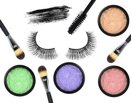 false eyelash: Black false eyelash, mascara, eyeshadows and brushes isolated on white background
