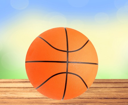 bight: Basketball ball on the table over bight nature background Stock Photo