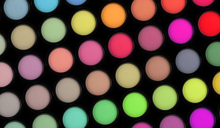 strewed: colorful eyeshadows such as fashion background Stock Photo