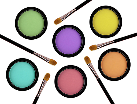 multicolored eye shadows and brushes isolated on white background Stock Photo