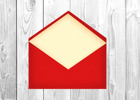enveloped: Red letter envelope with paper cardover white wooden background Stock Photo