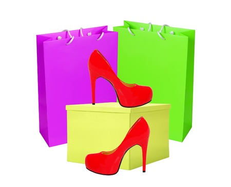 ship with gift: Red woman shoe, yellow gift box and shopping bags isolated on white background