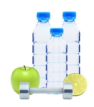 chromed: Blue bottles with water, chromed fitness dumbbells, lime and green apple isolated on white background