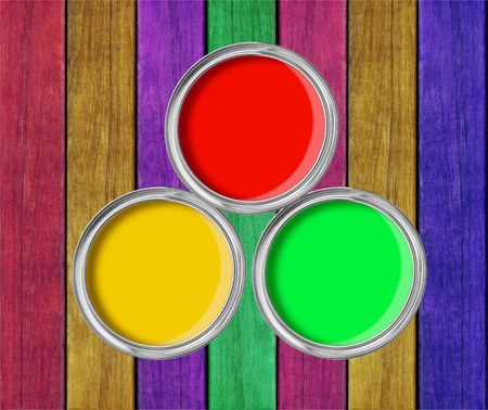 tin cans: open tin cans with paint on paint wooden background Stock Photo