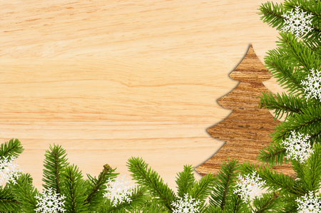 Vintage christmas background - old wood board with green christmas tree branch