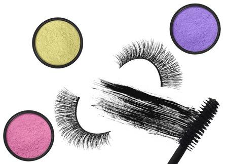 false eyelash: Stroke (sample) of black mascara, eyeshadows and false eyelash isolated on white macro
