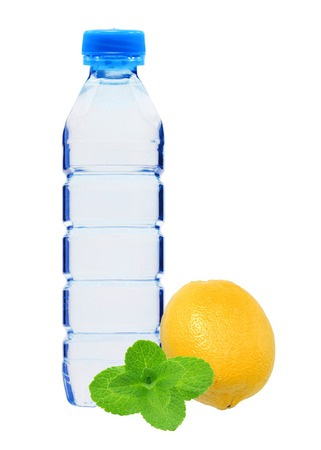 geen: Blue bottle with water, mint and fresh yellow lemon isolated on white background