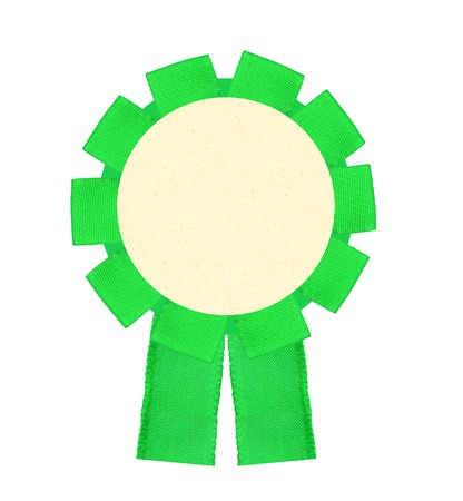 real trophy: Blank green award winning ribbon rosette isolated on white background