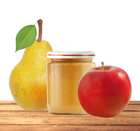 baby isolated: Jar of baby puree, apple and fresh yellow pear with green leaf isolated on white background Stock Photo
