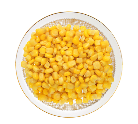 yellow corn: Sweet yellow corn grain on plate isolated on white background