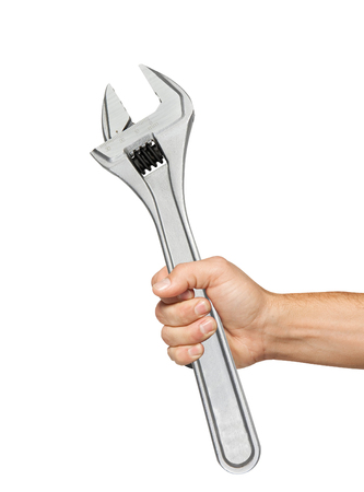 adjustable: Adjustable wrench in man hand isolated on white background Stock Photo