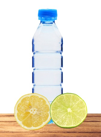 Plastik: Blue bottle with water and fresh lemon and lime isolated on white background Stock Photo