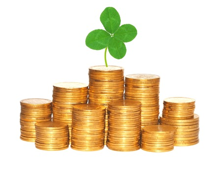 quarterfoil: Clover leaf and stacks of coins isolated on white background