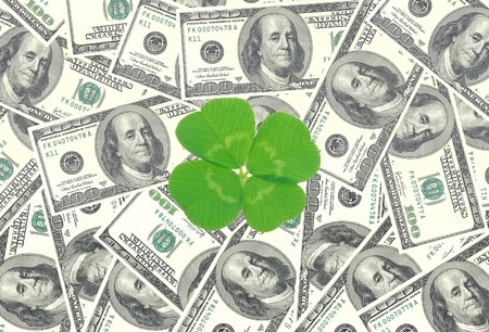 quarterfoil: Clover leaf and dollars, close-up Stock Photo