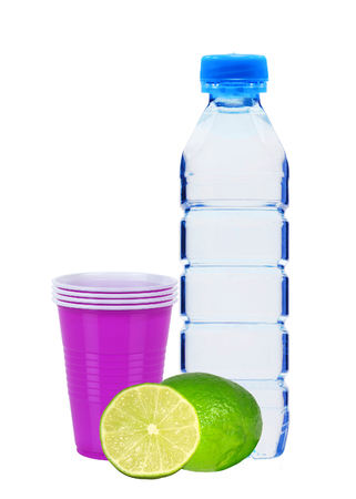geen: Blue bottle with water, lime and plastic cups isolated on white background