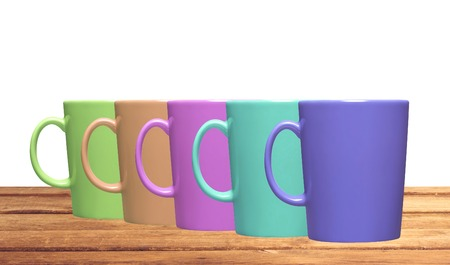 teacups: Set of colorful teacups on table isolated on white background