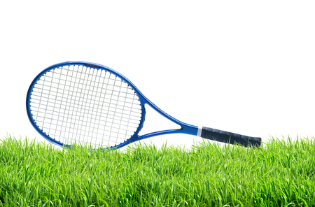 handled: Blue tennis racket on green grass isolated white background Stock Photo