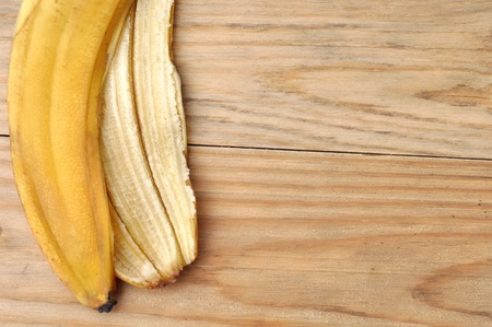 banana skin: banana skin (peel) on wooden table background