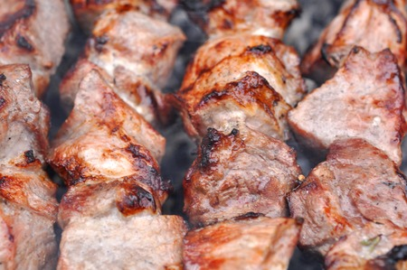barbequing: Roasted Barbecue Beef Meat Kebabs with Spice on Grill, Macro