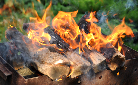 Hot Charcoal Barbecue Grill With Bright Flame On The Nature Background