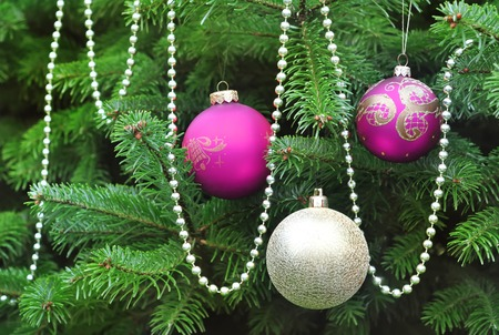 green christmas tree decorated with pink and gold balls closeup stock photo 66640562