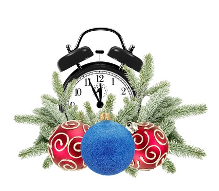 Green Christmas tree, decorative red balls and alarm clock isolated on white Stock Photo