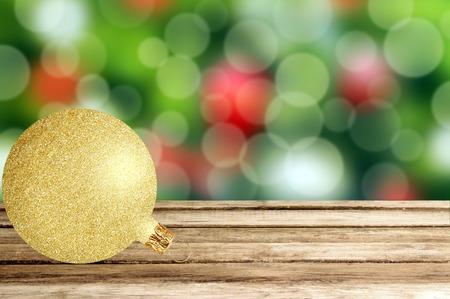 glitter ball: Gold glitter ball on christmas holiday background over festive bokeh Stock Photo
