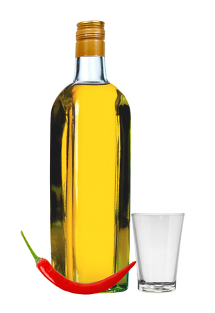 bottle of vodka with red pepper and glass isolated on white background