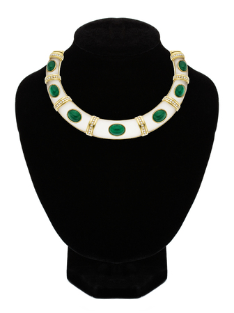 beautiful jewellery necklace with green stone on black mannequin isolated on white