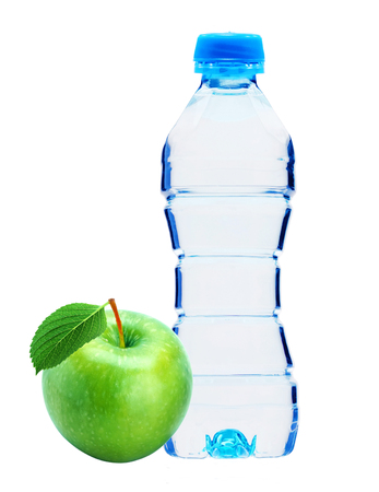 Blue bottle with water and fresh green apple isolated on white
