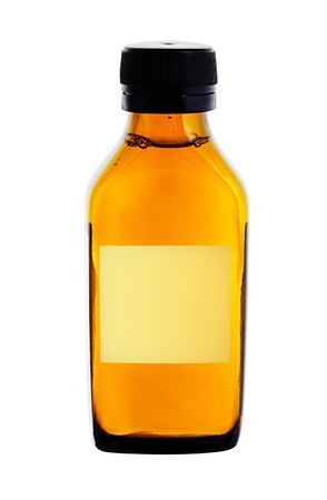 medicine bottle with yellow syrup isolated on white background