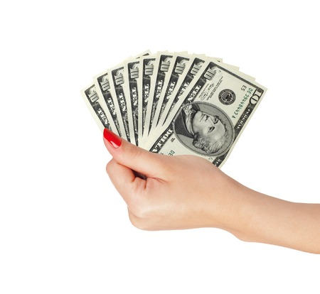 American dollars in a women hand isolated on white background
