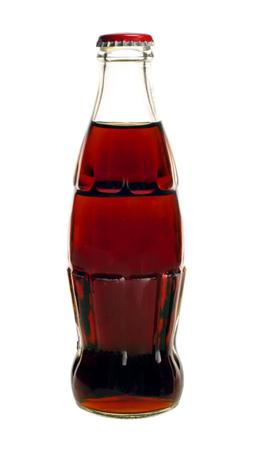 pocima: Botella de vidrio de soda de cola aislado en un fondo blanco Foto de archivo