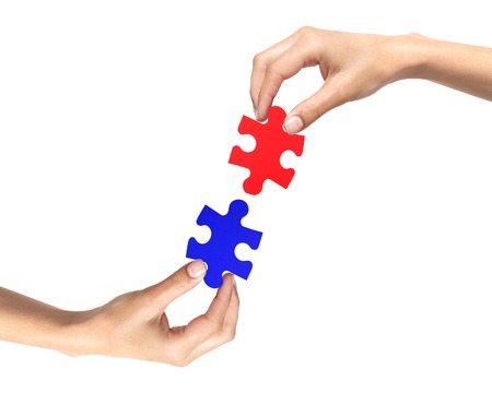 attach         â     â       ©: Red and blue puzzle in woman hands isolated on white