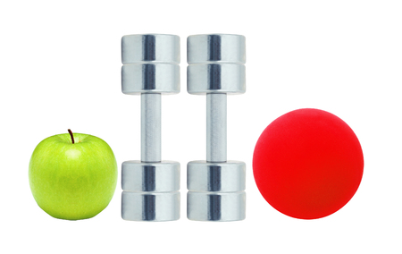 Chromed fitness dumbbells, red ball and green apple isolated on white background Stock Photo