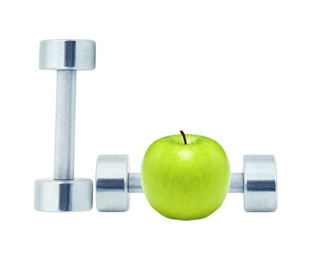 Chromed fitness dumbbells and green apple isolated on white background
