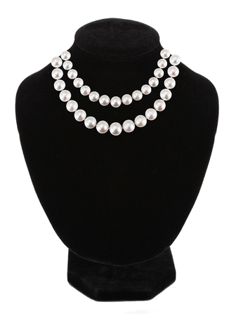 Pendant with gem stones pearls on black mannequin isolated on white