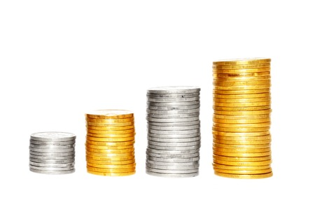 Savings, increasing columns of gold and silver coins isolated on white background Stock Photo