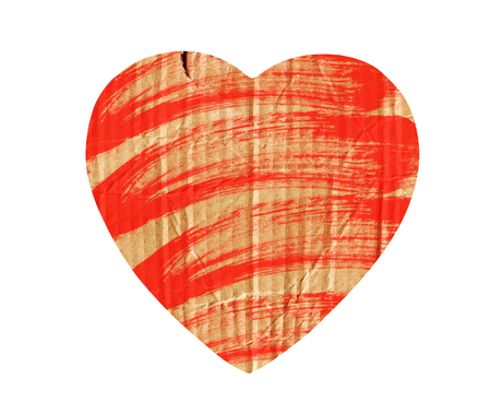 cardboard heart with red paint isolated on white