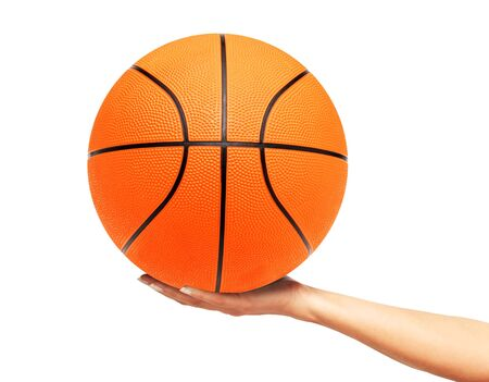 Basketball ball on woman hand isolated on white background