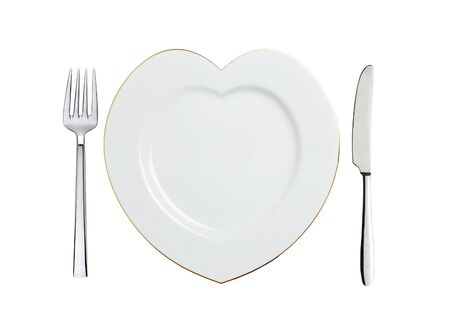white plate in shape of heart, spoon and fork isolated on white background Archivio Fotografico