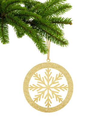 Golden Glitter Decorative Ball with Snowflake on Green Christmas Fir Tree isolated on White Background Zdjęcie Seryjne