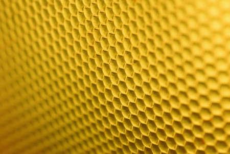 マルコ ショット ミツバチのハイブの黄色の形をした背景