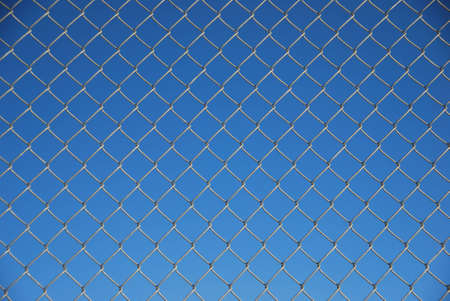 blue background with wire fence in front