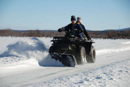 boy is plowing snow with an atv
