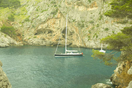 mallorca: sailing boat in a lonley ocean bay in mallorca spain Stock Photo