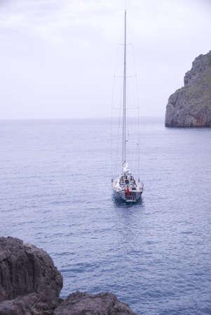 sailing boat in a lonley ocean bay in mallorca spain Stock Photo
