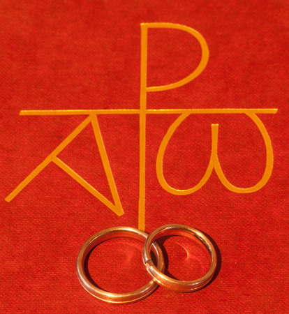 Bible with wedding rings Stock Photo