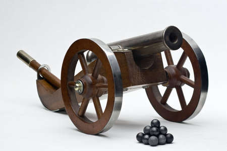 muzzleloader: small muzzleloader cannon with balls Stock Photo